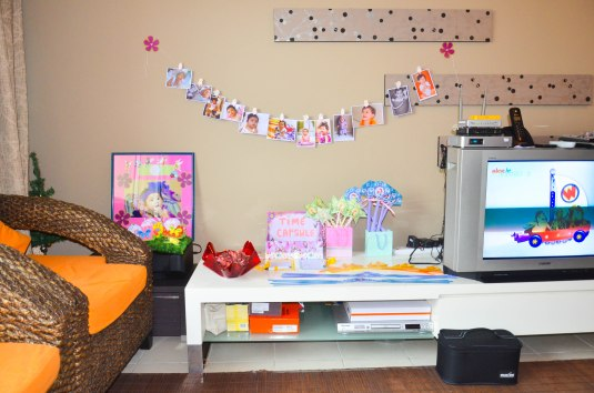 our sala, with Lyann's growing up baby pictures, and the time capsule for her